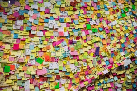 "A wall is covered in post-it notes of support of the pro-democracy movement next to the central government offices in Hong Kong on October 6, 2014. Hong Kong's pro-democracy protesters remained stubbornly encamped on the streets early Monday, just hours before a government deadline to clear key thoroughfares they have blockaded for more than a week. The city's embattled leader Leung Chun-ying has warned he will ""take all necessary actions to restore social order"" after a mass campaign for free elections that has seen tens of thousands of people pour onto the streets. AFP PHOTO / ALEX OGLE / AFP PHOTO / Alex Ogle"